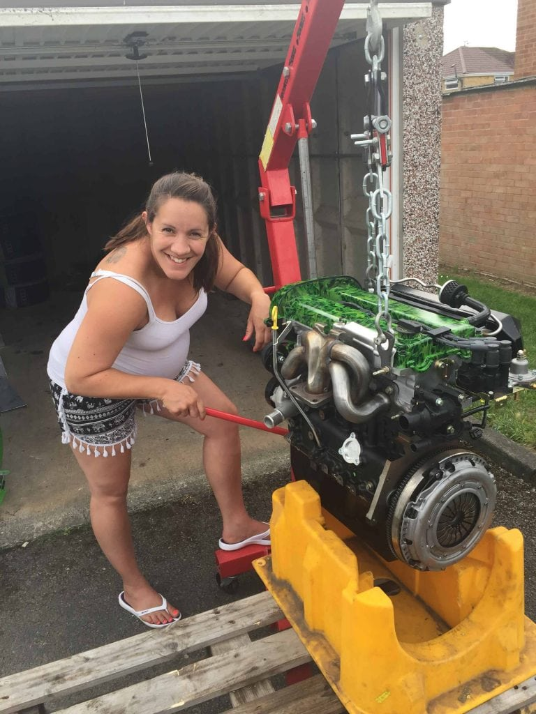 Helping my husband fit his engine, shortly before going into labour!
